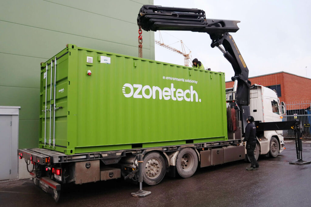 Container containing water treatment solution system